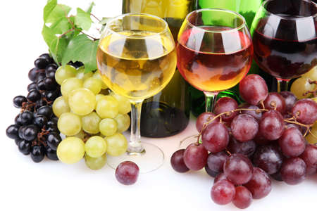 bottles and glasses of wine and assortment of grapes, isolated on white photo