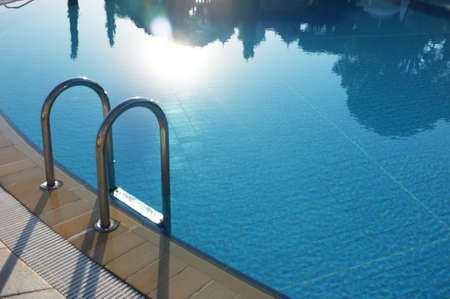 Hotel swimming pool with sunny reflections  photo