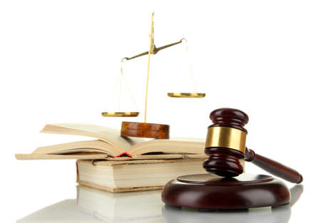 Golden scales of justice, gavel and books isolated on white photo