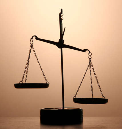 judicature: Gold scales of justice on brown background