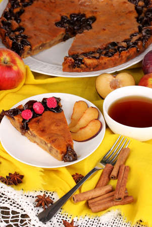 Tasty pie on plate on wooden table photo