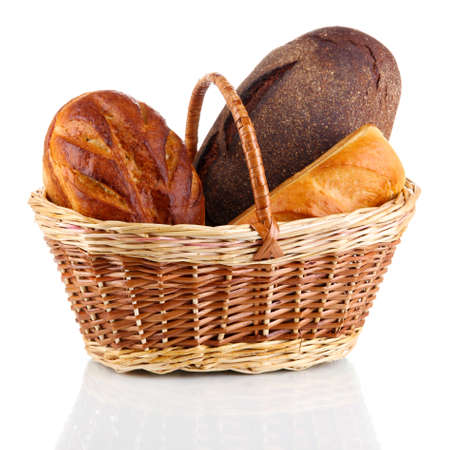 Fresh bread in basket isolated on white photo