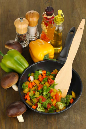 Sliced fresh vegetables in pan with spices and ingredients on wooden table Stock Photo - 17001858
