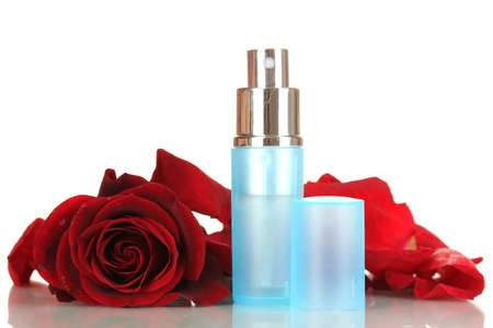 Womens perfume in beautiful bottle with rose isolated on white photo