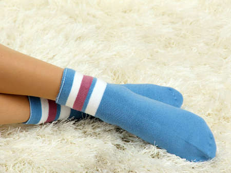 Female legs in colorful socks on  white carpet background Stock Photo - 17001573
