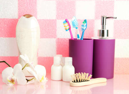 Bath accessories on shelf in bathroom on pink tile wall background Stock Photo - 16998945
