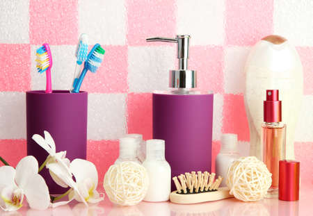 Bath accessories on shelf in bathroom on pink tile wall background Stock Photo - 17001122