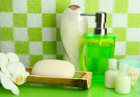 Bath accessories on shelf in bathroom on green tile wall background Stock Photo - 17001311