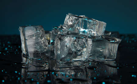 Ice cubes on dark blue background Stock Photo - 17001300