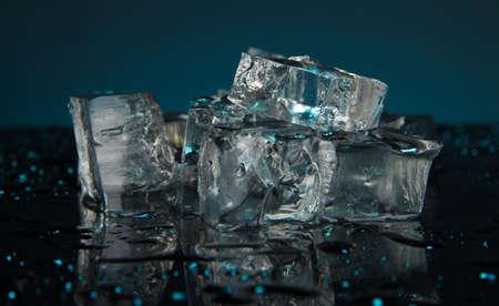 Ice cubes on dark blue background Stock Photo - 17001300