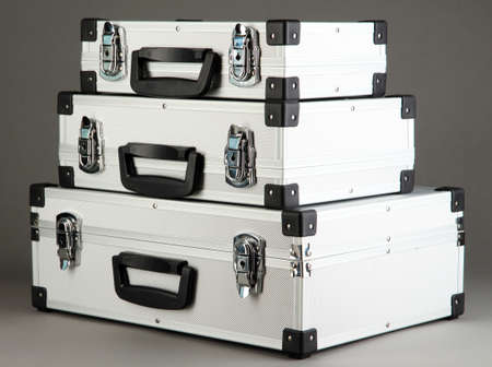 Silvery suitcases on grey background Stock Photo - 17001445