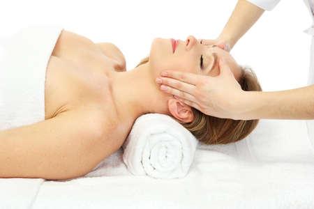 Portrait of beautiful woman taking head massage, isolated on white photo