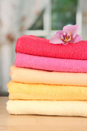Stack of towels with fragrant flower on window background Stock Photo - 17001560