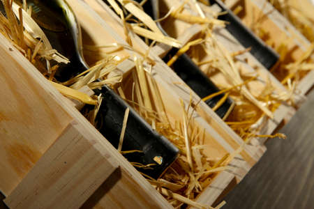 Wooden case with wine bottles close up Stock Photo - 17001476