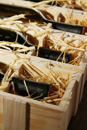 Wooden case with wine bottles close up Stock Photo - 17001467