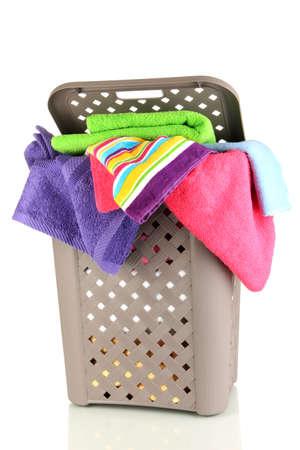 Beige laundry basket isolated on white photo