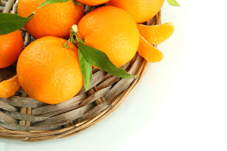 Ripe sweet tangerine with leaves, isolated on white photo
