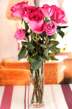 Beautiful pink roses in vase on table on room background Stock Photo - 17001148