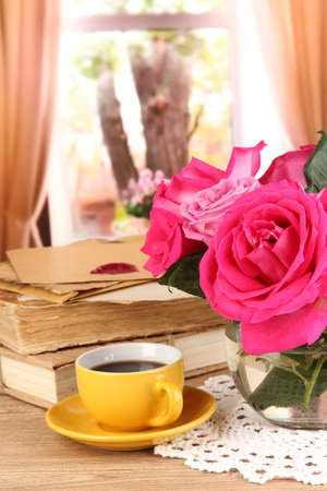 Beautiful pink roses in vase on wooden table on window background Stock Photo - 17001324