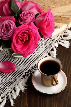 Beautiful pink roses in vase on wooden table close-up Stock Photo - 17001512