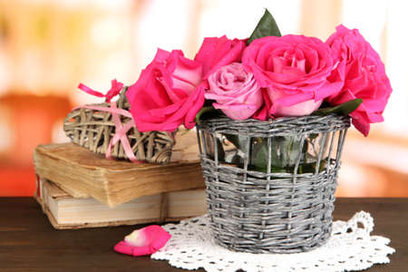Beautiful pink roses in vase on wooden table on room background Stock Photo - 17001253