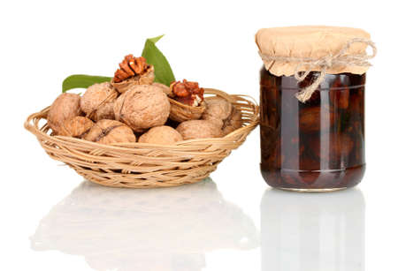 jam-jar of walnuts and a basket with walnuts photo
