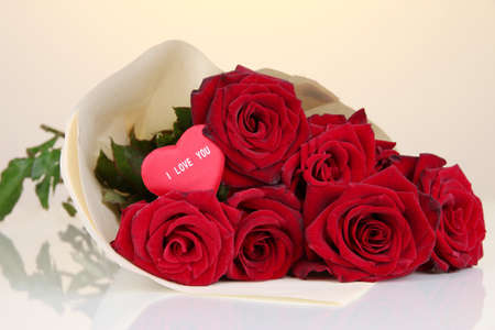 Beautiful bouquet of red roses with valentine on yellow background Stock Photo - 17036808
