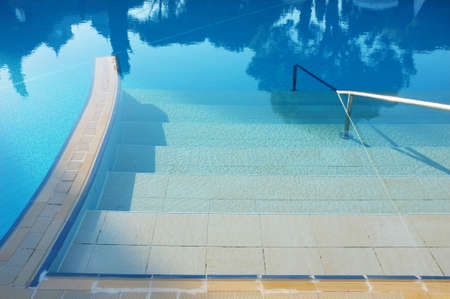 swimming pool with sunny reflections  photo