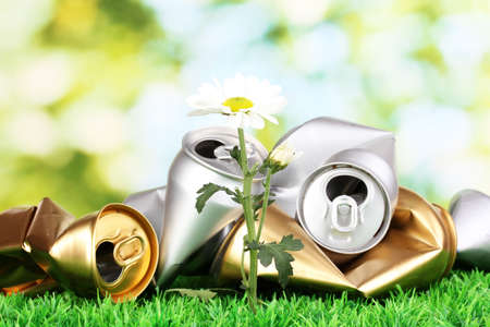 Garbage with growing flower. Environmental conservation concept photo