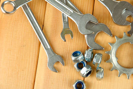 Machine gear, metal cogwheels, nuts and bolts on wooden background Stock Photo - 17038289