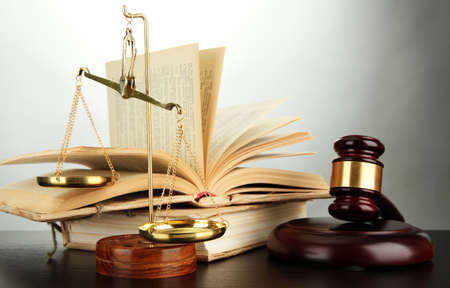 Golden scales of justice, gavel and books on grey background Stock Photo - 17037784