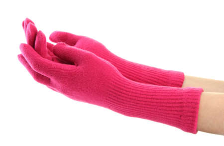 woman knitted gloves on hands, isolated on white photo