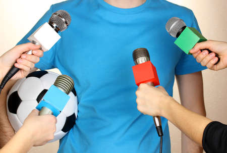 Conference meeting microphones and footballer Stock Photo - 17038026