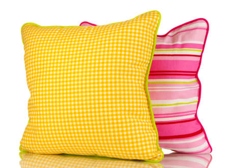 Yellow and pink bright pillows isolated on white photo