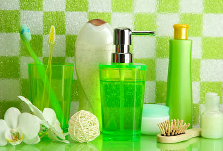 Bath accessories on shelf in bathroom on green tile wall background Stock Photo - 17038087