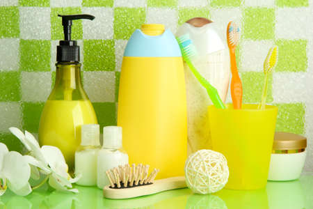 Bath accessories on shelf in bathroom on green tile wall background Stock Photo - 17038016