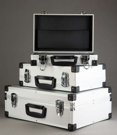 Silvery suitcases on grey background Stock Photo - 17038004