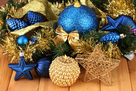 Christmas composition  with candles and decorations in  blue and gold colors on wooden background Stock Photo - 17038296