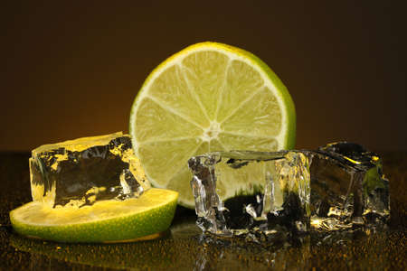 darck: Ice cubes with lime on darck orange background