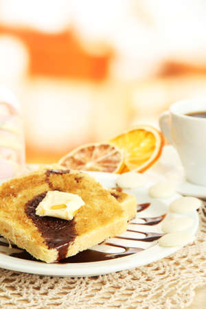 White bread toast with chocolate and cup of coffee in cafe photo