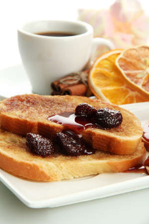 White bread toast with jam and cup of coffee, isolated on white photo