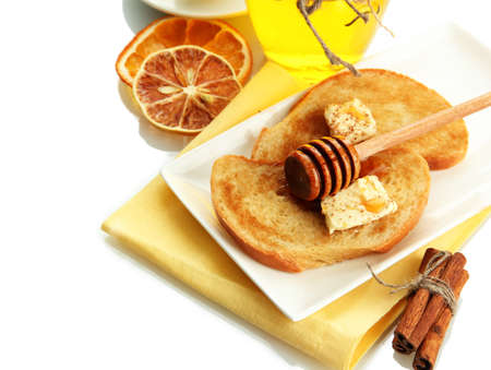 White bread toast with honey, isolated on white photo