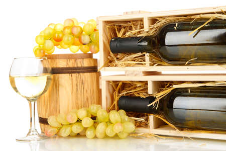 dura: Wooden case with wine bottle, barrel, wineglass and grape isolated on white Stock Photo