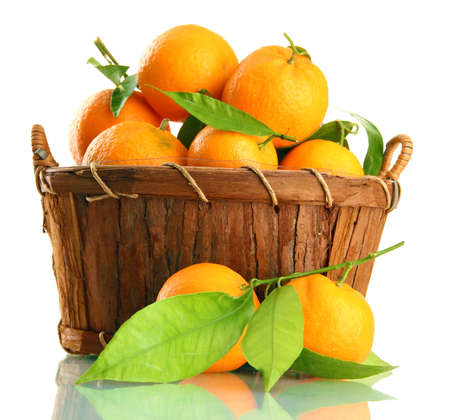 Ripe sweet tangerine with leaves in basket, isolated on white Stock Photo - 17037359