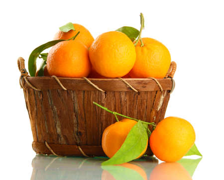 Ripe sweet tangerine with leaves in basket, isolated on white Stock Photo - 17037533