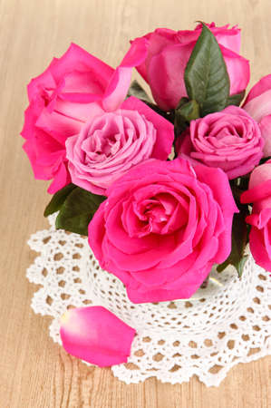 Beautiful pink roses in vase on wooden table close-up Stock Photo - 17037981