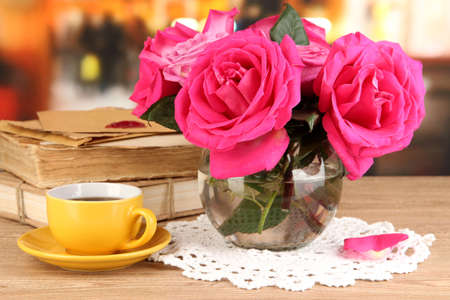 Beautiful pink roses in vase on wooden table on room background Stock Photo - 17038111