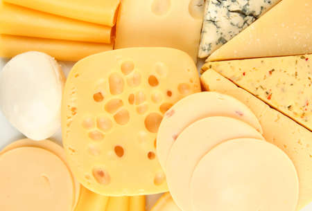 Various types of cheese close up photo