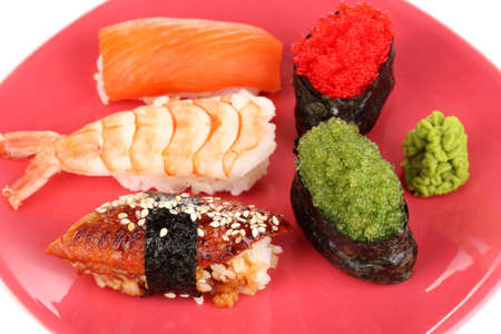 delicious sushi served on red plate close-up photo
