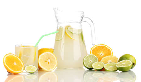 Citrus lemonade in pitcher and glass of citrus around isolated on white Stock Photo - 17051992